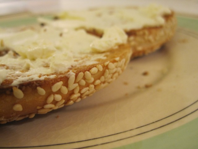 A sesame bagel from Roni's, toasted and spread with cream cheese